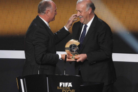 Brazil's national soccer coach Scolari presents FIFA Men's Coach of the Year 2012 trophy to del Bosque of Spain during FIFA Ball
