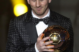 Messi of Argentina FIFA World Player of the Year 2012 holds his FIFA Ballon d'Or trophy during the FIFA Ballon d'Or 2012 soccer