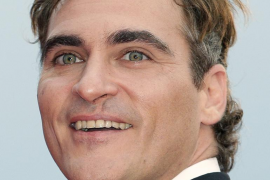 """File photo of actor Joaquin Phoenix posing on red carpet during a screening for the movie """"The Master"""" at the 69th Venice Film F"""