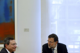 European Central Bank President Draghi and Spanish PM Rajoy talk at start of their meeting at Madrid's Moncloa Palace