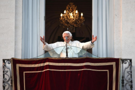 Pope Benedict XVI waves to the faithful for the last time from the balcony of his summer residence in Castel Gandolfo