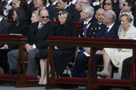 Monaco's Prince Albert and Princess Charlene sit with Belgium's King Albert and Queen Paola before the inaugural mass of Pope Fr