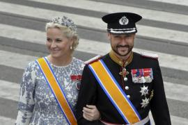 Crown Prince Haakon and Crown Princess Mette-Marit of Norway arrive for a religious ceremony at Nieuwe Kerk church in Amsterdam