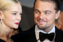 Cast members Leonardo DiCaprio and Carey Mulligan arrive on the red carpet for the screening of the film 'The Great Gatsby' at t