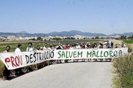 Medio centenar de personas marchan por l'Horta del Molinar