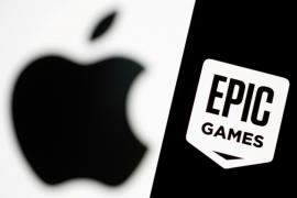 FILE PHOTO: Smartphone with Epic Games logo is seen in front of Apple logo in this illustration