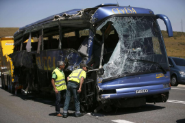Civil guards inspect the wreckage of a bus crash near Avila, central Spain