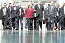 Merkel y los socialdemócratas acuerdan negociar la gran coalición