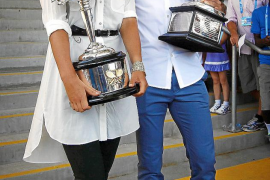 Current Australian Open tennis champions Djokovic and Azarenka pose with the championship trophies to the official draw ceremony