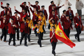 Spain's flag-bearer Javier Fernandez leads his country's contingent during the opening ceremony of the 2014 Sochi Winter Olympic