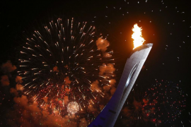 Fireworks explode after the Olympic Cauldron is lit during the opening ceremony of the 2014 Sochi Winter Olympics