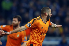 Real Madrid's Benzema celebrates his goal against Schalke 04 during their Champions League soccer match in Gelsenkirchen