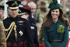 Britain's Catherine, Duchess of Cambridge and her husband Prince William wear sprigs of shamrock during a visit to the 1st Batta