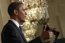 President Barack Obama addresses a news conference in the East Room of the White House in Washington