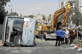 An overturned bus lies at the scene of a suspected attack in Jerusalem