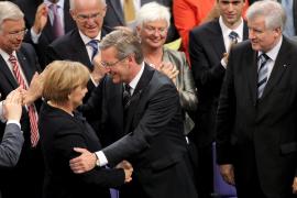 Merkel, humillada al ser elegido a la tercera su candidato a jefe de Estado