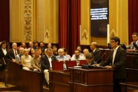 El PP y Podemos se disputan el   control del Govern en el Parlament