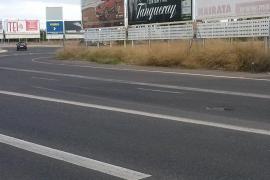 Agujero en el asfalto