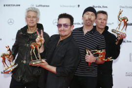 File photo of U2 posing with their Music International trophies during Bambi 2014 media awards ceremony in Berlin