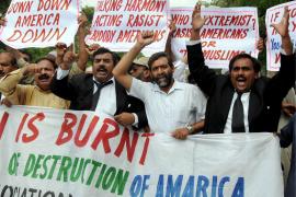 La presión internacional obliga al reverendo a cancelar la quema del Corán