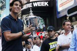 Rafael Nadal of Spain, winner of the 2010 U.S. Open tennis tournament, poses with the trophy at Times Square in New York