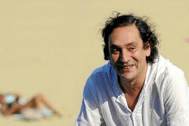 Spanish film director Villaronga smiles during a photo call on the sixth day of the 58th San Sebastian Film Festival.