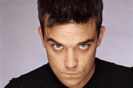 Robbie Williams compró armas para defenderse de sus fans