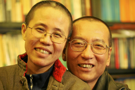 Chinese dissident Liu Xiaobo and his wife Liu Xia pose in this undated photo released by his family