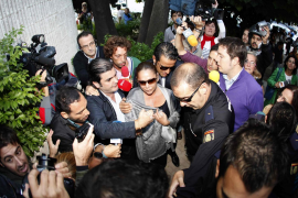 Spanish singer Isabel Pantoja is surrounded by the media as she arrives at a court in Marbella