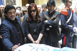 Handout image of Argentine President Fernandez standing with Maradona and Bolivia's President Morales in front of coffin of her