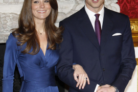 Britain's Prince William and his fiancee Kate Middleton pose for a photograph in St. James's Palace in central London