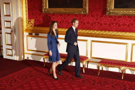 Britain's Prince William and his fiancee Kate Middleton prepare to pose for a photograph in St. James's Palace in central London