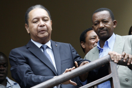 Former Haitian dictator Duvalier walks with friends before being escorted from his hotel by police in Port-au-Prince