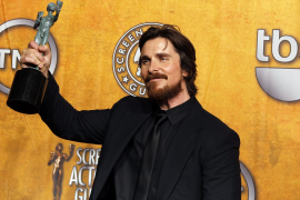 """Actor Christian Bale poses with his award backstage for outstanding performance by a male actor in a supporting role in """"The Fig"""