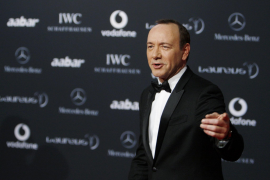 Actor and host for the event Kevin Spacey jokes on the red carpet as he arrives for the Laureus World Sports Awards in Abu Dhabi