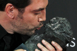 Spanish actor Javier Bardem kisses his award for Best Actor at the Spanish Film Academy's Goya awards ceremony in Madrid