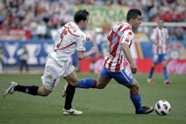 Atlético y Sevilla igualan un duelo trepidante