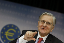 Jean-Claude Trichet, President of the European Central Bank (ECB) answers reporter's questions during his monthly news confrence