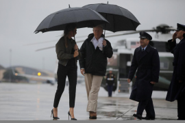 U.S. President Donald Trump and first lady Melania Trump board Air Force One for travel to Texas from Joint Base Andrews, Maryla