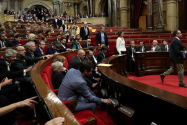 Deputies from Popular Party (PP) abandon the chamber during a plenary session at the Catalan regional Parliament in Barcelona