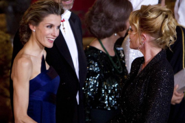 Spain's Princess Letizia shakes hands with actress Melanie Griffith before a gala dinner in Madrid