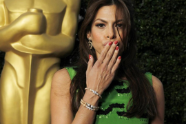 Actress Eva Mendes poses at the Academy of Motion Picture Arts & Sciences Tribute to Sophia Loren in Beverly Hills