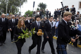 Seve Ballesteros' son Miguel carries an urn containing his ashes during the Spanish golfer's funeral in Pedrena, northern Spain