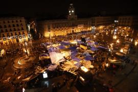 Demonstrators gather and shout slogans in Madrid's famous landmark Puerta del Sol