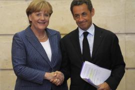 Sarkozy y Merkel piden suspender los fondos para los países que no rebajen el déficit