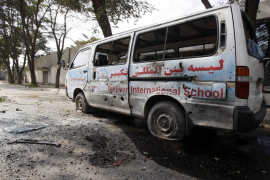 A damaged vehicle is seen after a rocket-propelled attack in Kabul
