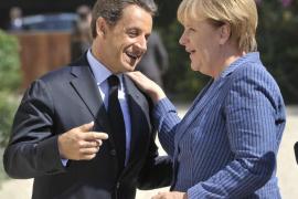 Merkel y Sarkozy manifiestan su apoyo a Grecia, que se compromete con las reformas
