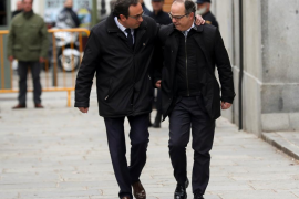 Catalan politicians Rull and Turull arrive to the Supreme Court after being summoned and facing investigation for their part in
