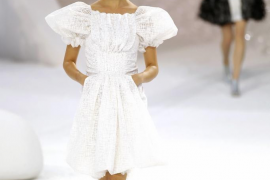 A model presents a creation by German designer Karl Lagerfeld for Chanel as part of his Spring/Summer 2012 show in Paris