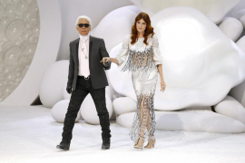 German designer Lagerfeld appears with Florence Welch at the end of his Spring/Summer 2012 show for Chanel in Paris